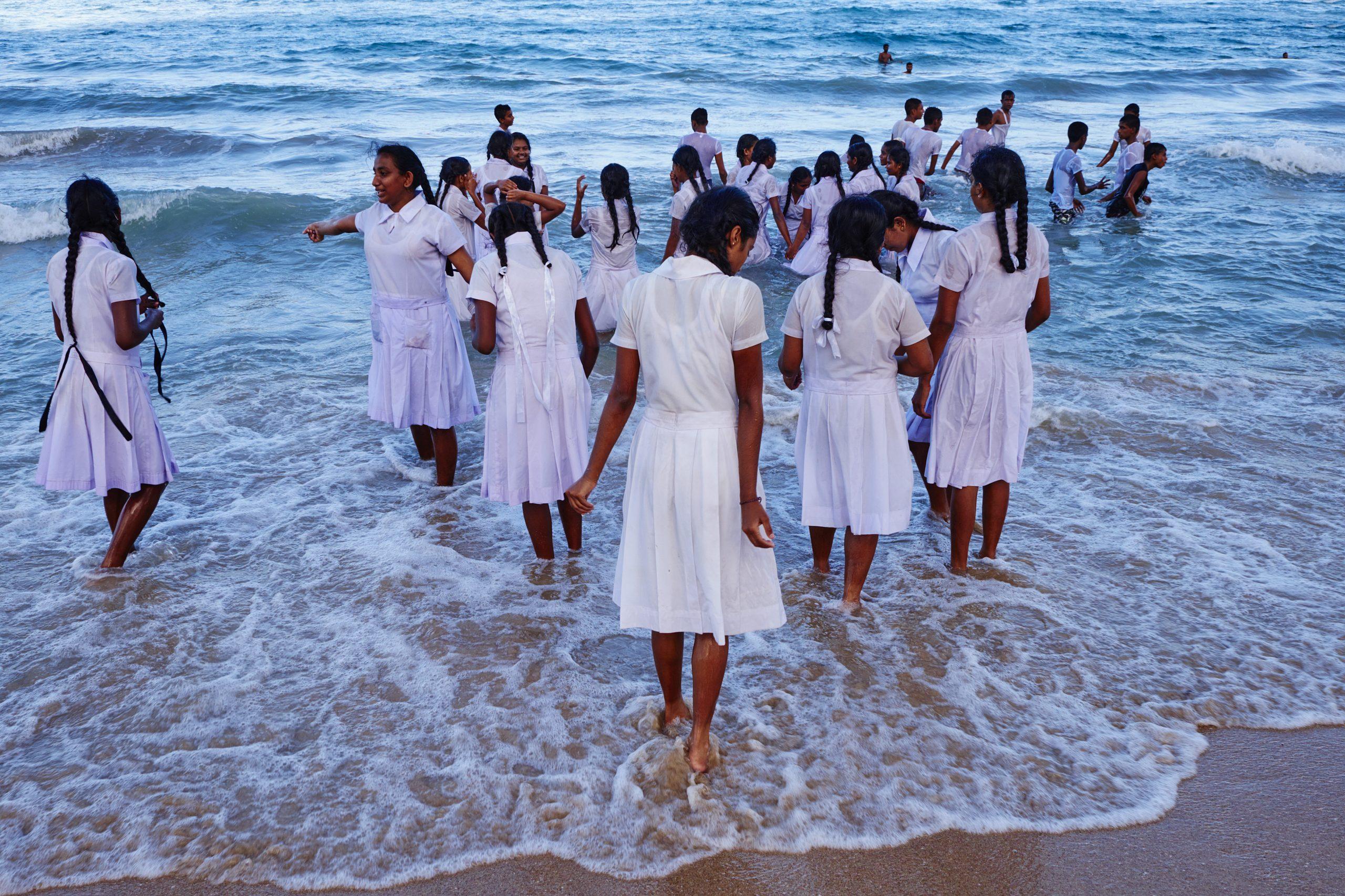 Sri Lanka, Trincomalee, shcool girls play on the sea